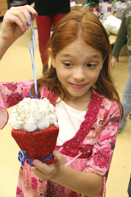 COULD IT BE POPCORN? Destinee Santiago with her ornament.