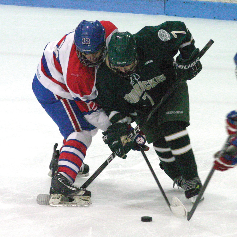 Tucker Alberigo battles for a face-off. The  Hawks won 2-1 and beat Cranston West 6-0 on Saturday.
