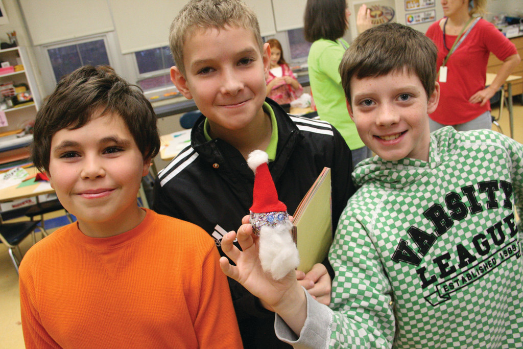 THEIR SANTA: Willem Nanian, James Smith and Daniel Johnson hold the Santa ornament they made.