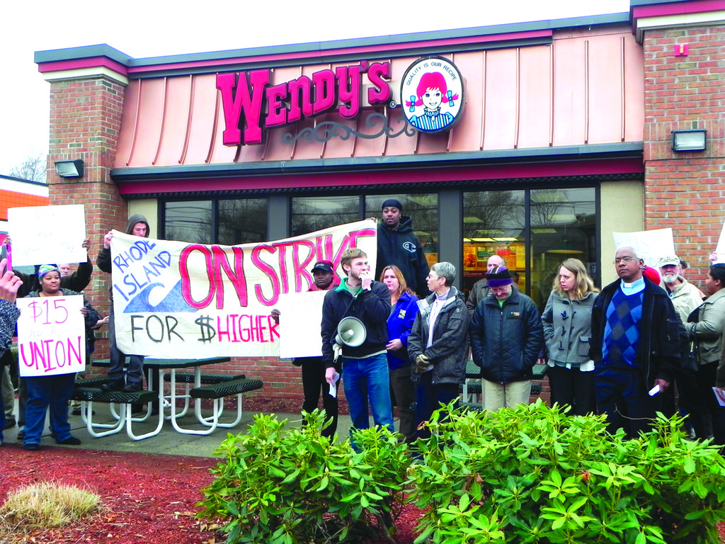 DEMONSTRATION: Dozens of fast-food workers, joined by community, religious and political leaders, marched to the Wendy's location at 771 Warwick Ave. in a demonstration calling for higher wages Dec. 5.