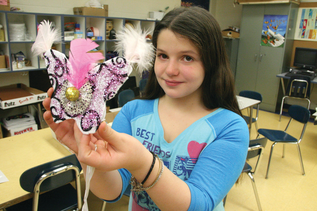FEATHER WINGS: Emma Laurenzo with her butterfly ornament.