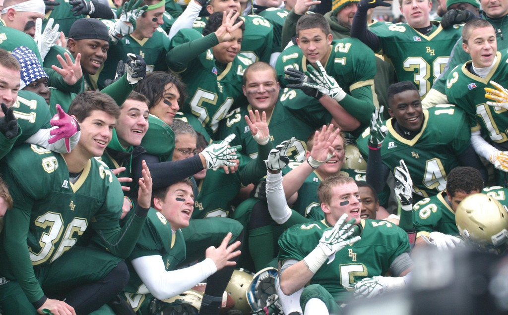 GOING FOR FIVE: The Bishop Hendricken football team, shown last season celebrating a fourth straight championship, will be gunning for a fifth this fall.