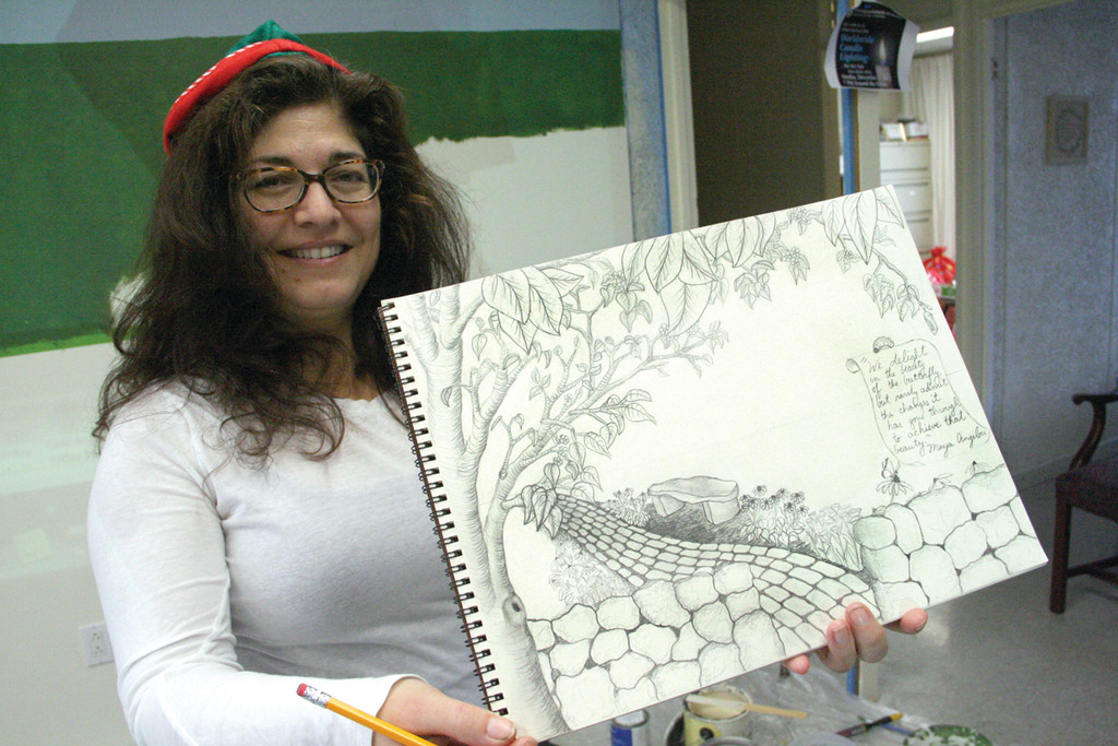 COMING TO LIFE: Artist Elizabeth Alvares holds a sketch of the mural that will adorn the wall behind her at Friends Way.