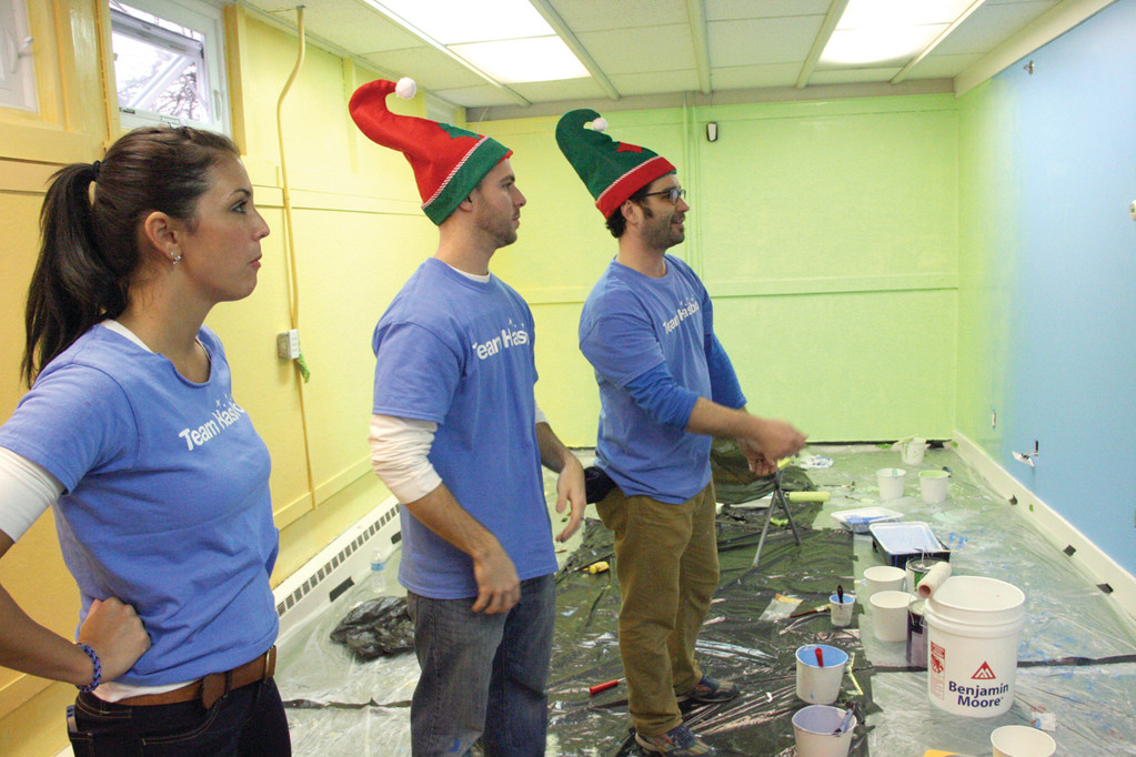 VEILS OF COLOR: Hasbro team volunteers Jen DeAngelis, Jake Levesque and Jason Beene survey their work after carefully transitioning colors in one of the rooms the crew painted at Friends Way as part of Hasbro's Global Day of Joy.