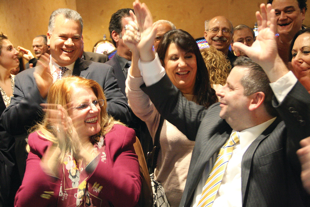 Rep. Slater celebrates his $10,000 win for the Assumption of the BVM Church Food Pantry.