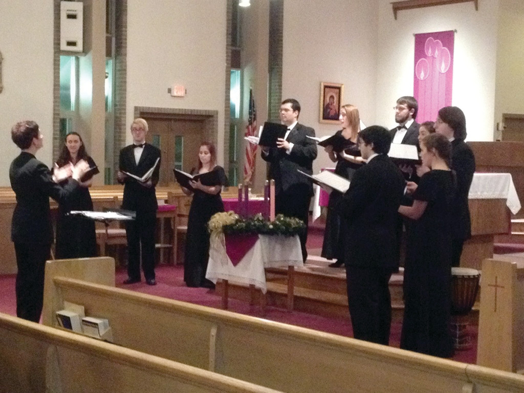 WELCOMING THE SEASON: Student members of the Rhode Island College choir entertain the 100 guests at the St. William advent concert on Dec. 7.