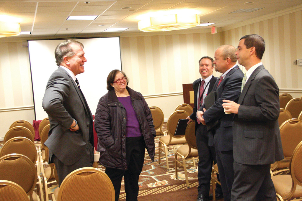 THEIR FULL ATTENTION: Following Tuesday's meeting, Ward 3 Councilwoman Camille Vella-Wilkinson got to talk with Kelly Fredericks, RIAC president and CEO, and other RIAC officials, Dan Porter, Peter Frazier and Brian Schattle.