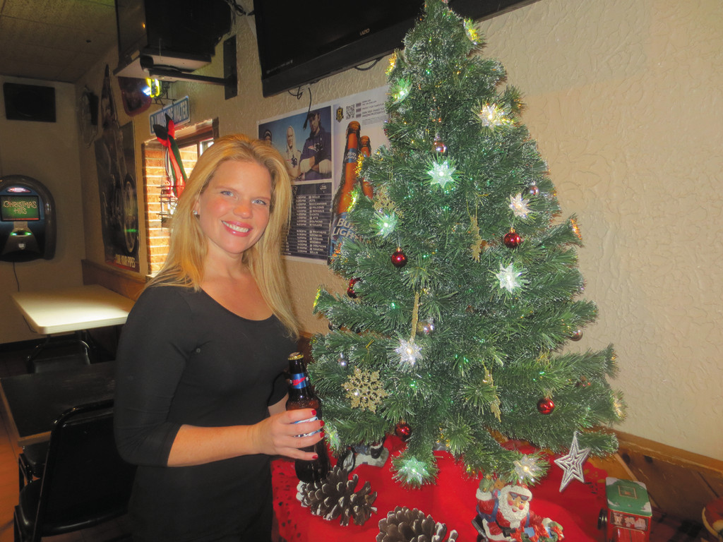 New to Backstreet, bartender Heather raises a beer to welcome in 2014 and to wish all their customers a happy and safe new year.
