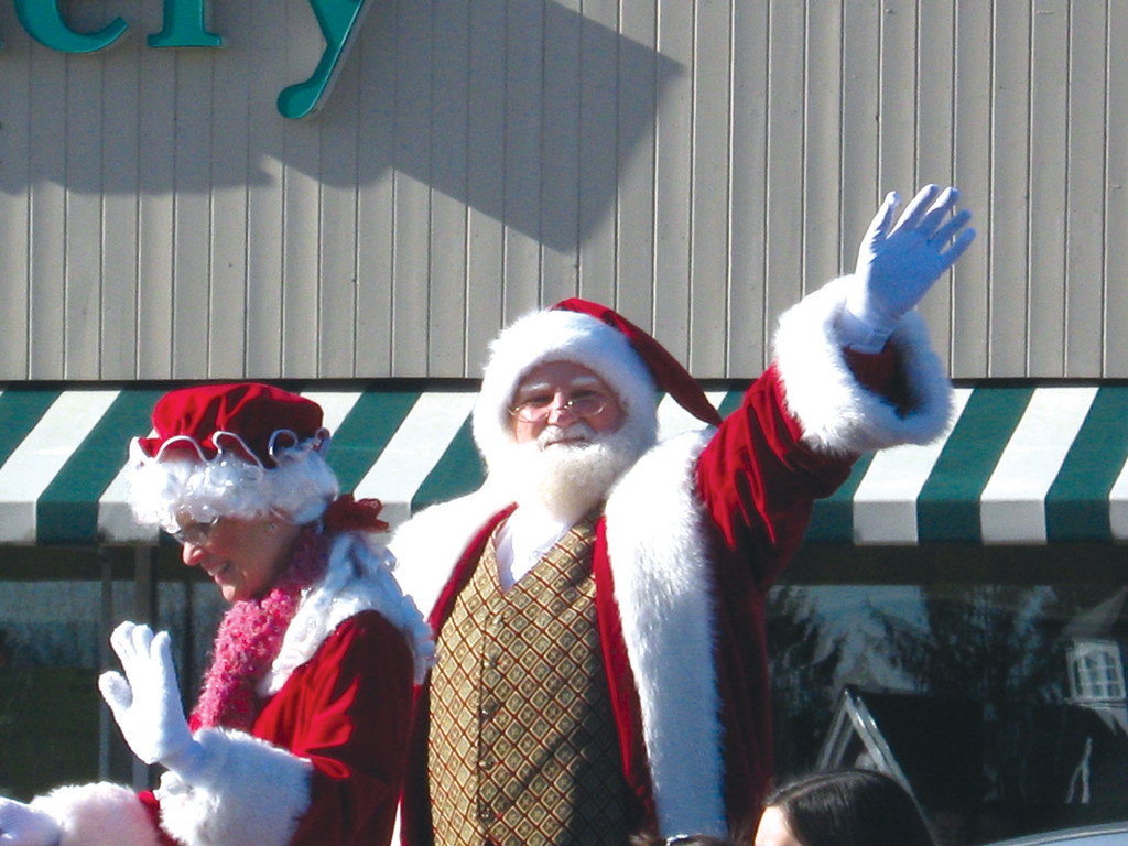 SANTA'S ARRIVAL: Santa and Mrs. Claus arrived in Garden City in a horse-drawn carriage for their 25th year this past Nov. 30. He has donned the Santa suit for approximately 35 years; beginning as a senior in high school.