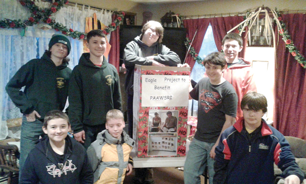 CREATIVE TEAMWORK: Chris Gomm, assistant scoutmaster of Troop 7 Buttonwoods, was assisted by his fellow troop members in decorating donation boxes for a collection drive he's running as part of his Eagle Scout project to gather items for the PAAWS RI animal shelter program. Troop 7 members include: Back row, from left, Aiden Meservey, David Cerullo, Chris Gomm and Angus Nathan; and front Row, from left, Michael Graves, Danny Meservey, Collin Leven and Liam Redmond.