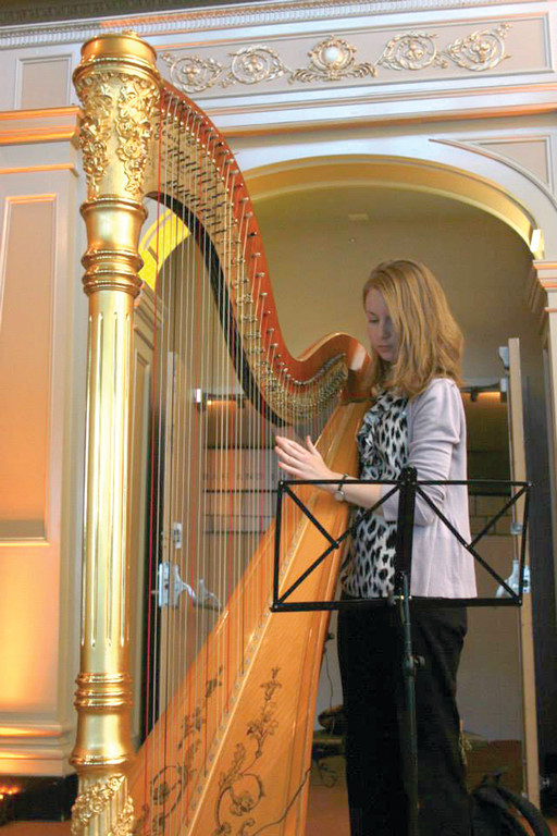 STRIKING CHORDS: Molly McCaffrey is a harpist from Boston and one of many musicians The Savory Affair uses for events that call for music.