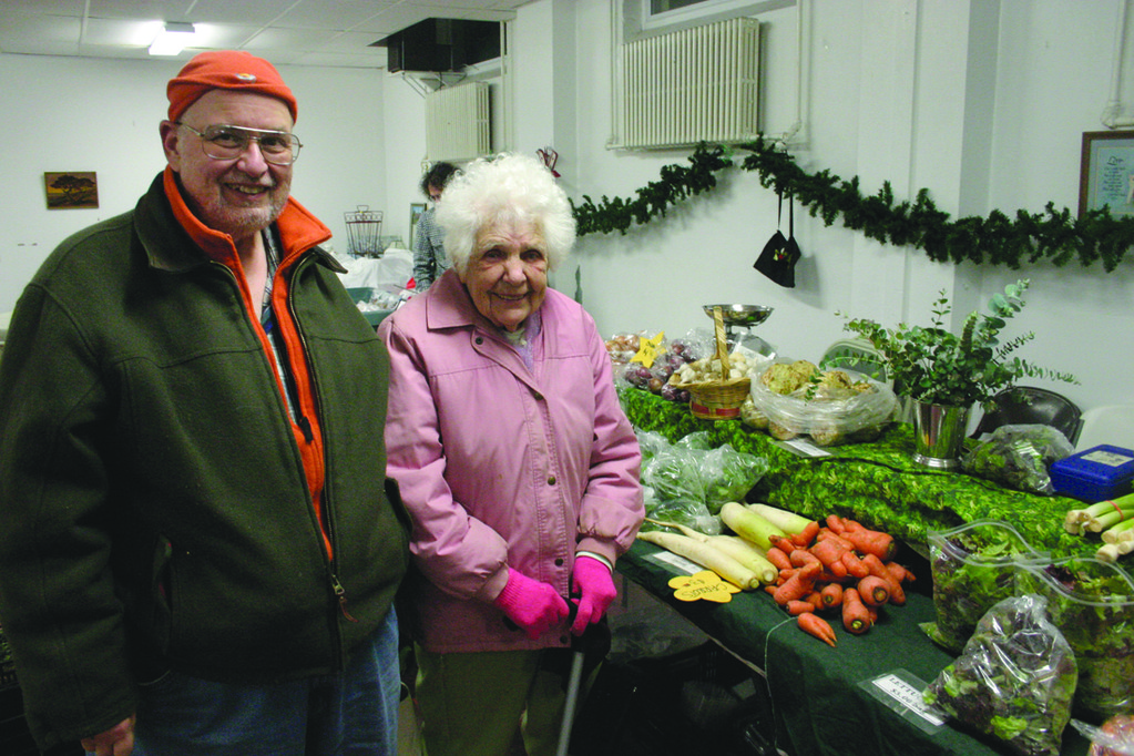 "TRIP TO THE MARKET: Stephen A. Martin and Alice Laurenson were among those visiting the Paxtuxet Village Farmer's Market's recent winter market. Martin said he enjoys the atmosphere and the opportunity to support local vendors. ""It just feels so good,"" he said."