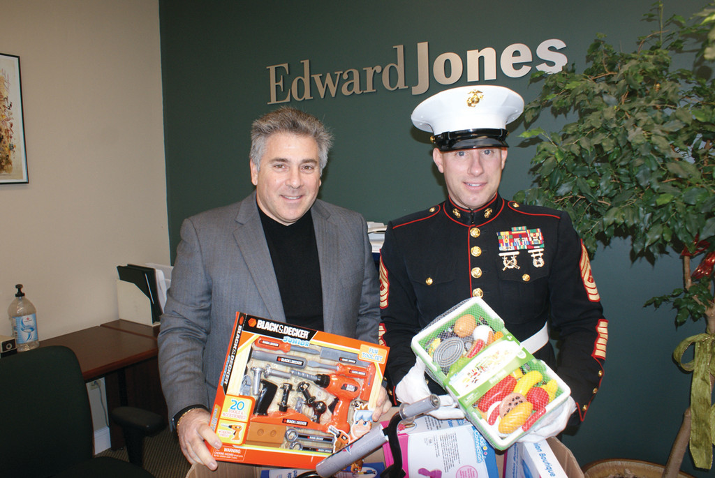 GIFTS FROM THE HEART: Pictured are Michaelangelo Rosado, Nicole Nichols and Marine Corps Reserve MSgt. Frank Impagliazzo, who picked up the last box of toys from Subway at 475 Atwood Ave. in Cranston on Dec. 28.