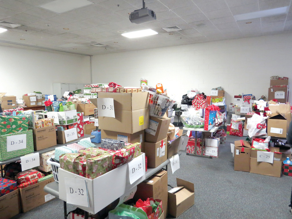 WON'T FIT UNDER THE TREE: The Doctor's Auditorium at Kent Hospital was filled with gifts for 42 families, all of whom remained anonymous, including household items, food for Christmas dinner, clothing and toys. Volunteers could not wait to see the faces of the receiving families, who often have no idea what to expect.