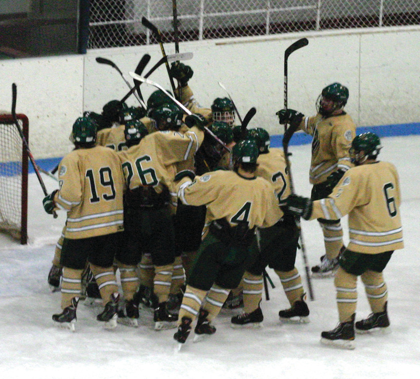 PILE ON: Hendricken's hockey team celebrates after winning the championship game at the Mount St. Charles Holiday Face-off on Saturday.