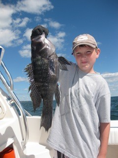 "Black sea bass quota: Quinn (Squid) Antonacci of West Greenwich with the 22"" black sea bass he caught on his grandfather Ken Robinson's boat. RI is trying to get BSB quota liberalized."