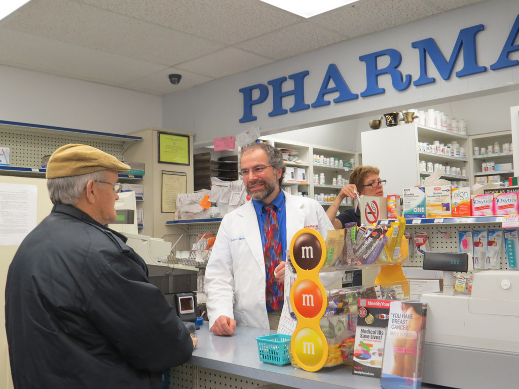 A FAMILIAR FACE: Customers coming into Suburban Pharmacy know owner Nick Shanos by name, and he knows them. Many even remember Shanos as a child, helping out at the family business.
