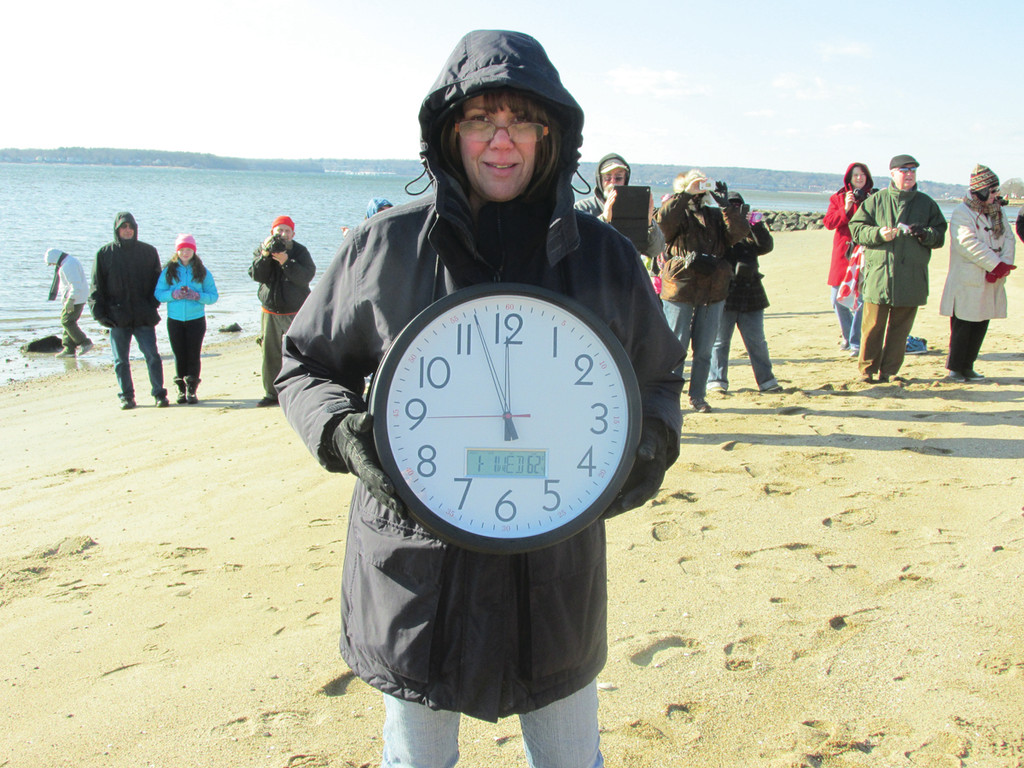 CHILLING COUNTDOWN: The bone-chilling 16-degree temperature – and off-shore breeze – didn't dampen the spirits of Doreen Kosciusko, chairperson of the Oakland Beach Carousel's annual Seawall Splash that went off last Wednesday at high noon.