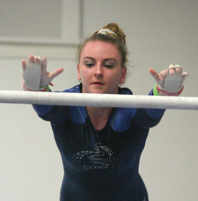 Kate Eminger competes on bars.