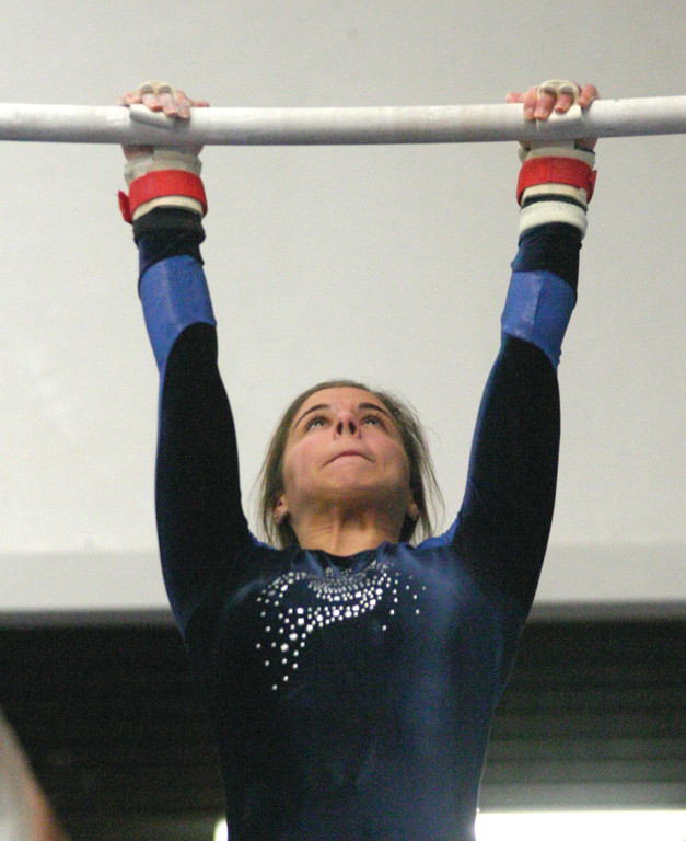 EYE ON THE BAR: Toll Gate�s Kate Foeller competes on bars during Sunday�s meet against Warwick Vets and West Warwick. Foeller is one of two sophomores on a team that�s dominated by underclassmen. The Titans don�t have a single senior.