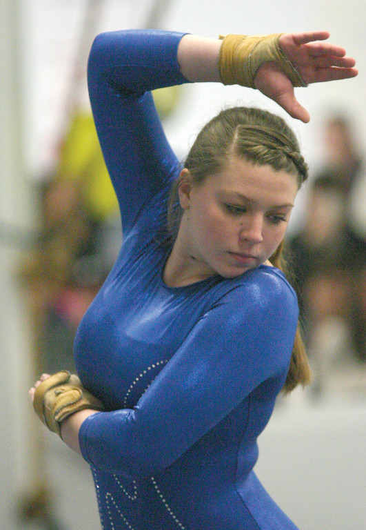 Michaela McNally holds a pose during her floor routine on Sunday.
