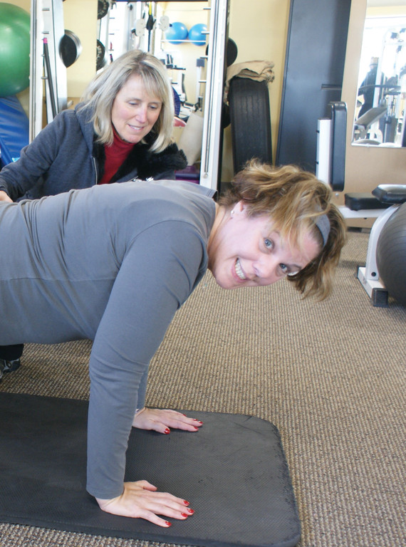 WORK OUT: Pictured is School Committee member Paula McFarland with Body Complete Fitness owner Donna Spinelli working out early Saturday morning on Jan. 4. McFarland has been on a personal healthy lifestyle and fitness journey and will continue in this New Year.