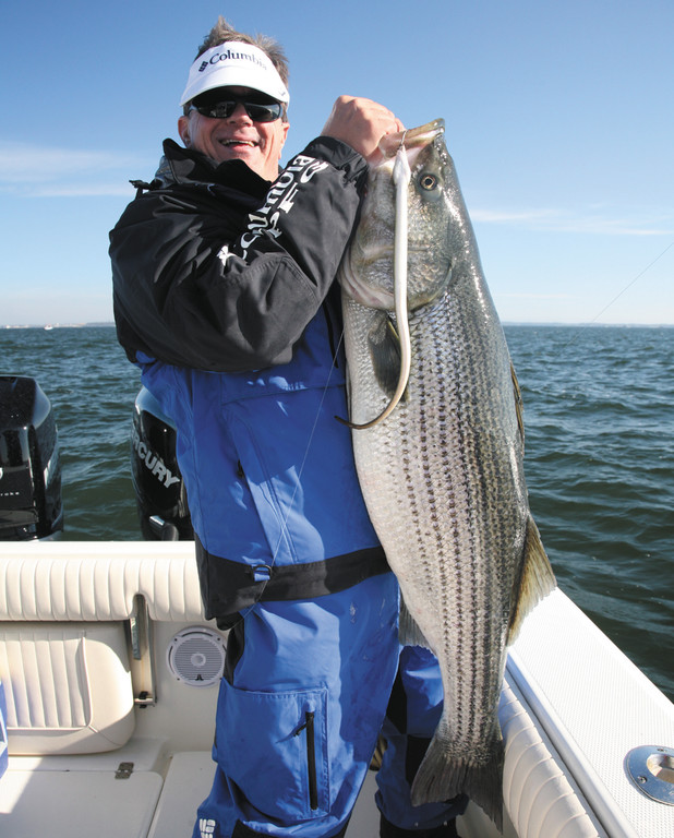 All smiles: George Poveromo after landing this 39-pound striped bass outside of Chesapeake Bay.  He will host the January 18th Salt Water Sportsman National Seminar Series at the Mohegan Sun Casino.