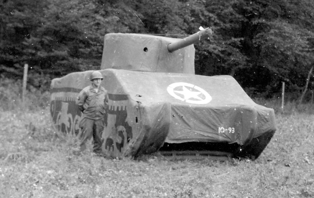 A Ghost Army soldier and a dummy M4 Sherman tank