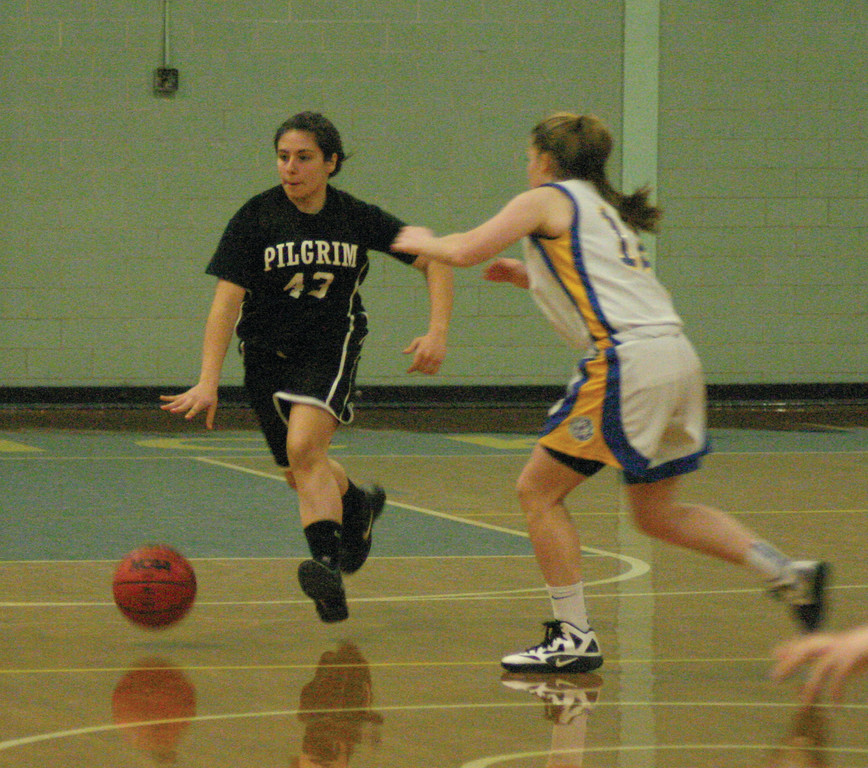 Alexia Martins dribbles away from Casey Bennett.