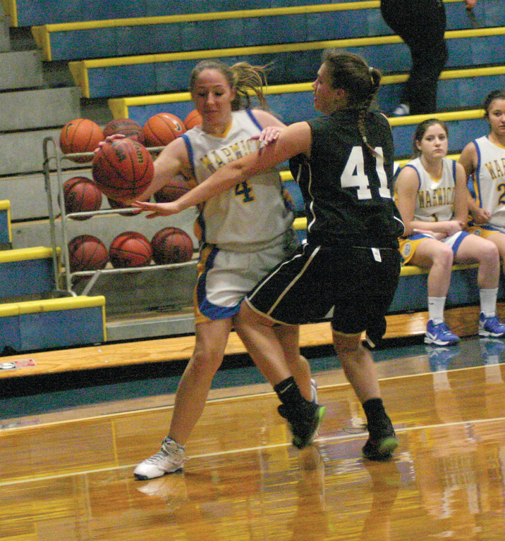 BASELINE: Vets' Abbie Paul tries to get around Pilgrim's Erin Plowman during the second half of Tuesday's game.