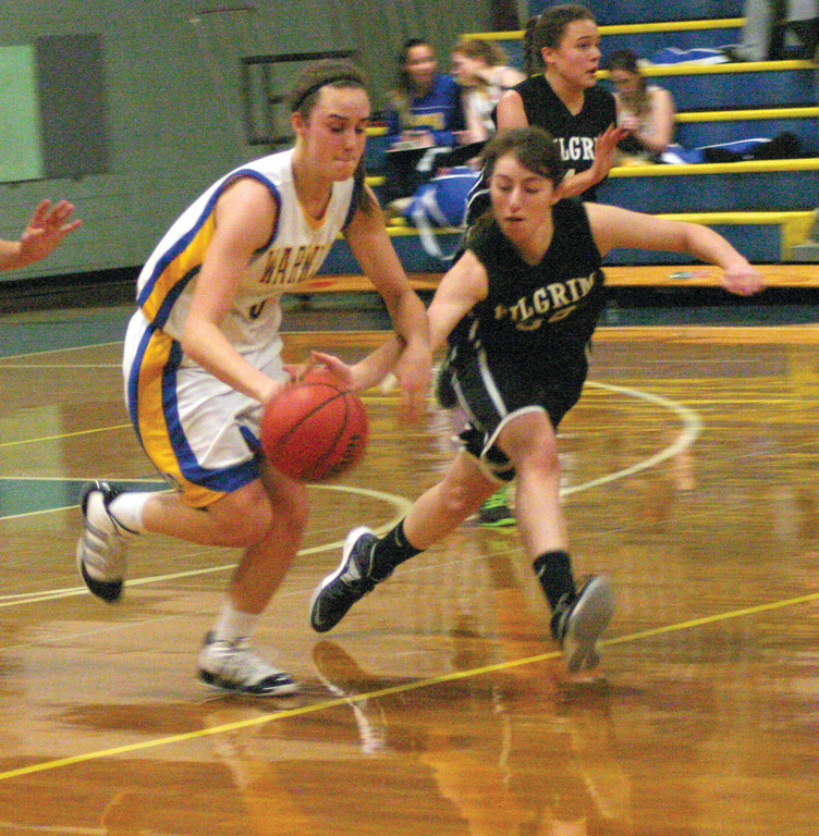 HOLDING ON: Vets' Lauren Almonte tries to keep her dribble away from Pilgrim's Alexa Annotti in Tuesday's game. The 'Canes won 47-35.
