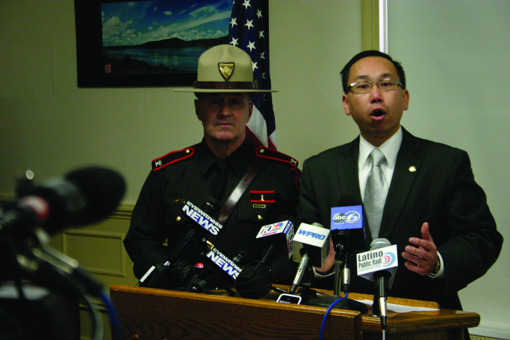 State Police Col. Stephen O'Donnell looks on as Cranston Mayor Allan Fung addresses members of the media during a Friday press conference at City Hall.