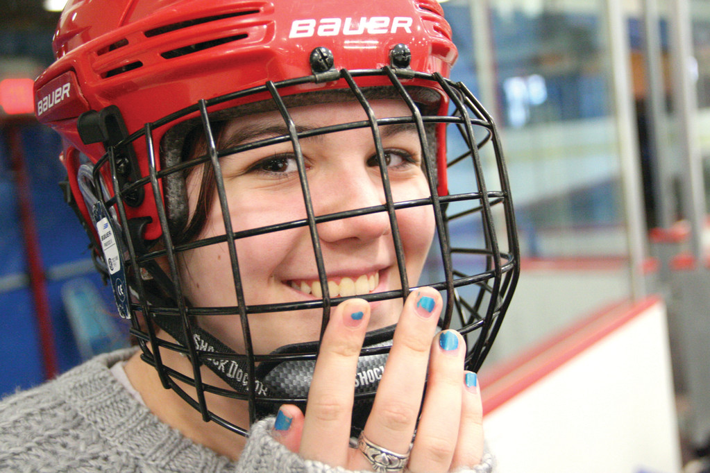Samia Pratt, who plays left wing, suffered a concussion while playing ice hockey for the Lady Titans. Until she is cleared to return to the ice, she shows up for games and practices and, for good measure, wears her helmet.