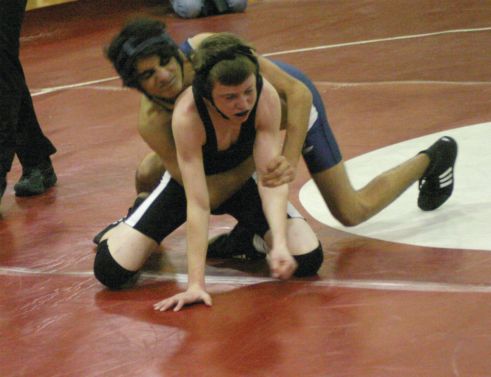 STILL FIGHTING: Pilgrim's John Castaldi tries to break free during his first match of the day at 106 pounds on Thursday.