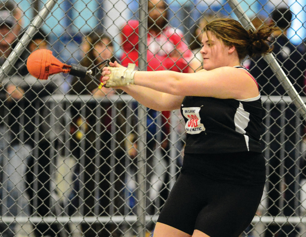 FULL TILT: Pilgrim's Maddison Caron throws the weight during the Rhody Classic on Saturday. Caron finished fourth in the event and was one of the Pats' top finishers.