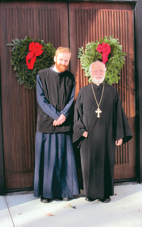 MAKING HISTORY: Matthew Jeremy Baker, left, a Cranston native, will be ordained Sunday as a priest in the Greek Orthodox Church. He is shown with his mentor, the Rev. Andrew George, pastor of the Church of the Annunciation in Cranston.