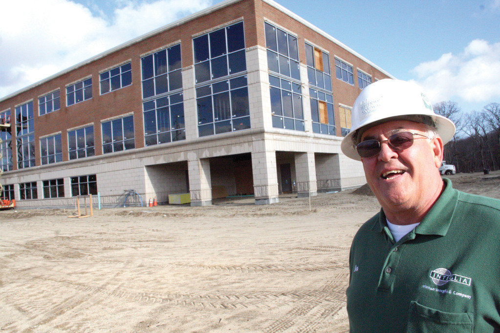 READY THIS YEAR: New headquarters for Coastway Community Bank currently under construction in Metro Center in Warwick should be open by the second quarter of the year. The 45,000-square-foot building is costing $8.8 million. Seen here is Robert Mandeville, site supervisor for Integlia Construction.