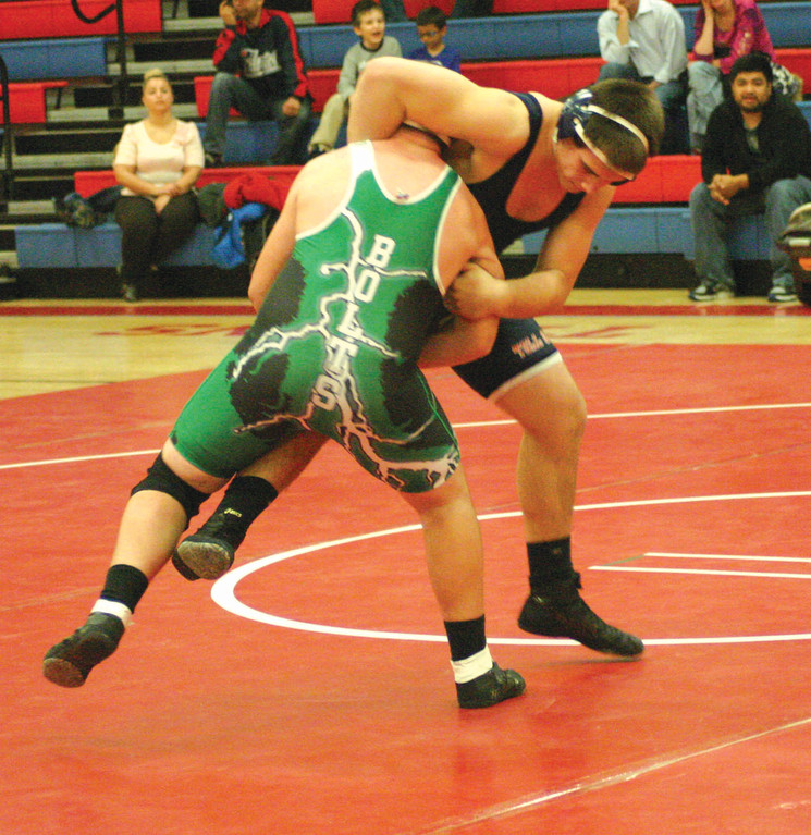 LOCKING IT UP: Toll Gate's Ed Pierce takes control in his 195-pound match against Cranston East Tuesday night. The Titans cruised to a 58-24 victory, improving to 6-0 on the season.