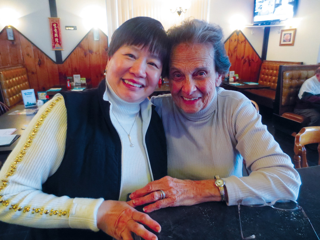 Judy Chin relaxes with her longtime friend and server Margaret Brodeur between serving a house of hungry diners at Jade Dragon.