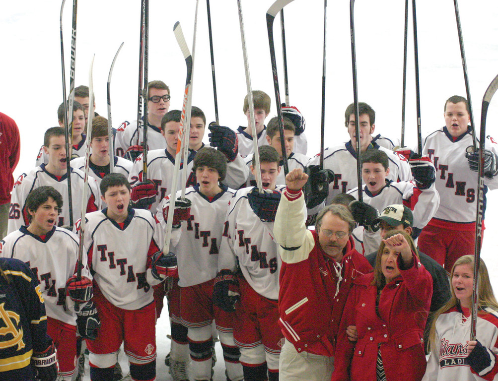 STICKS UP FOR 8: The Gauthier family and members of the Toll Gate hockey team salute the banner honoring Andrew Gauthier during Sunday's Andrew J. Gauthier Hockey Festival at Thayer Arena. The seventh annual event featured five high-school games, plus an alumni game for former teammates of Andrew and his brother, Bobby.