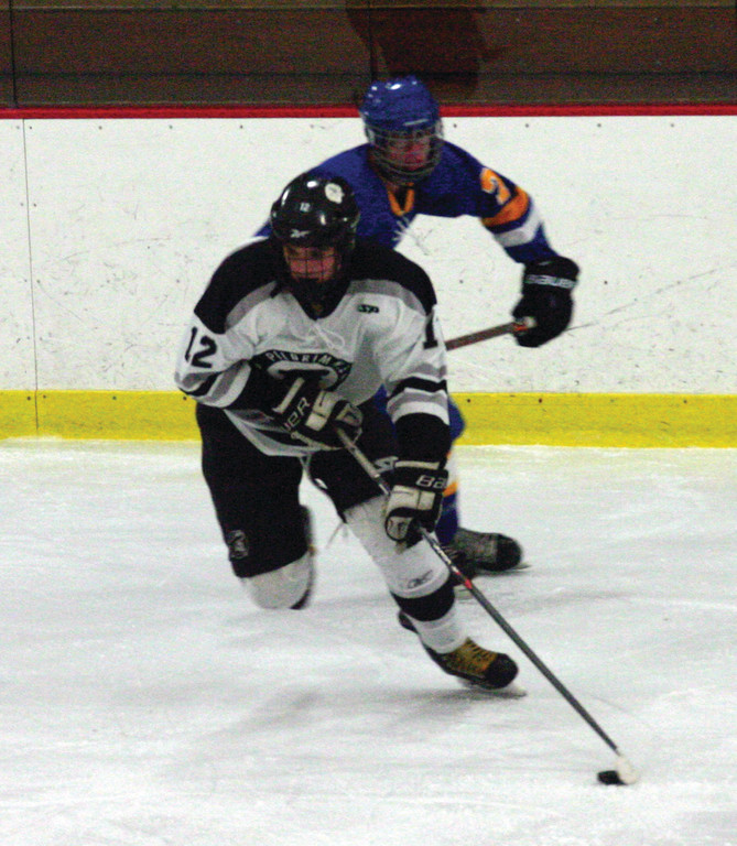 PUSHING: Sam Adamo tries to hold off a Vets' skater.