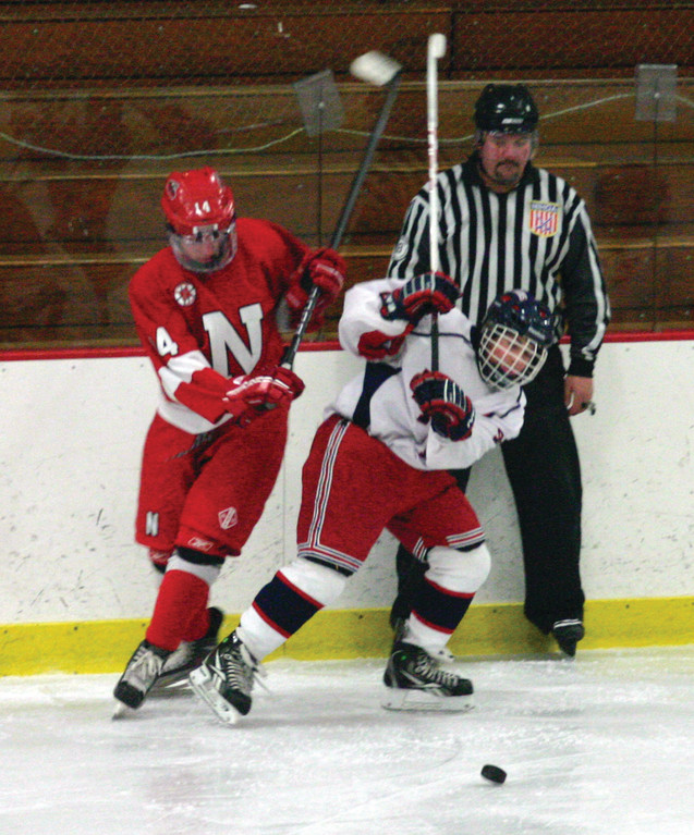 Toll Gate's Chris Williams battles for the puck.