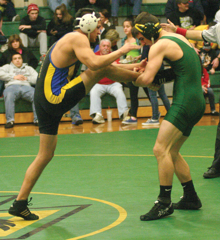 UPPER HAND: Hendricken's Anthony DiMauro takes hold of his opponent from North Providence in the 145-pound weight class on Thursday. The Hawks cruised to wins over the Cougars and Warwick Vets.