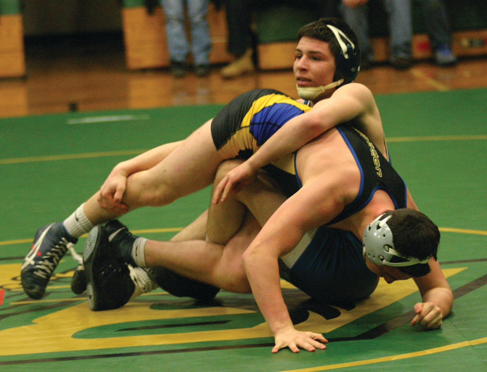 HANGING ON: Vets' Tom Galligan wrestles against North Providence at 160 pounds on Thursday.