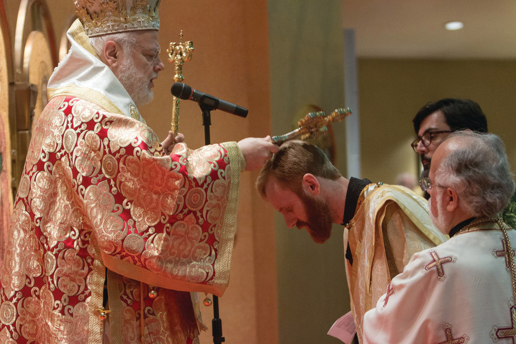 SPECIAL MEMORY: His Eminence Methodios, Greek Orthodox Metropolitan of Boston, left, begins the ordination of Matthew Baker, bowing.