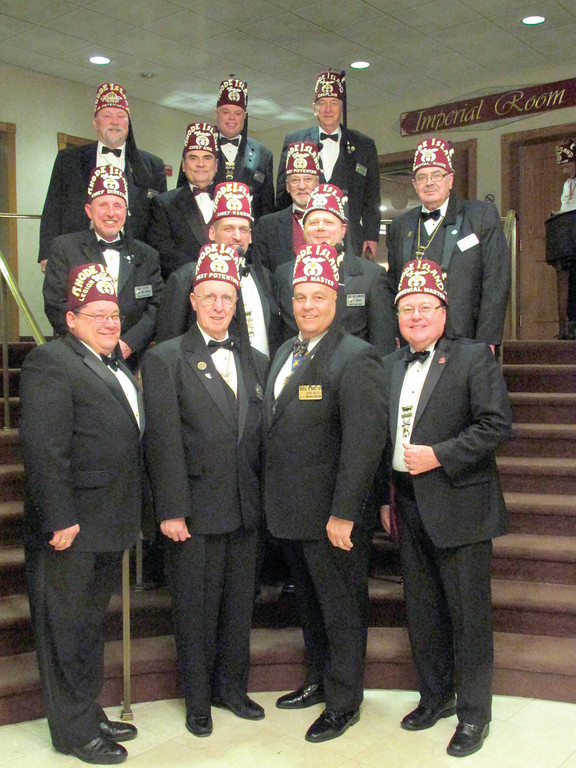 NEW YEAR: The 2014 officers of the Rhode Island Shriners gather during Friday's gathering at the Imperial Room. Pictured, front row from left, are Captain of the Guard Norman F. Messinger, Illustrious William J. Hall, 2014 Potentate of the Rhode Island Shriners, Most Worshipful Grand Master of Masons for the State of Rhode Island and Providence Plantations Russell R. Davis Sr., and 2nd Ceremonial Master Robert J. St. Jean; second row from left, Director Robert M. Chase Jr., Chief Rabban Glenn E. Mederios and 1st Ceremonial Master Donald L. Williamson Jr.; third row from left, Assistant Rabban Andrew B. Hencler, Chief Aide Joseph Andrade, Past Potentate (1999) Clark W. Cate and Oriental Guide Louis B. Sherman; and fourth row from left, Treasurer Bryan A. Martin and Chaplin Steven M. Kemp Jr.