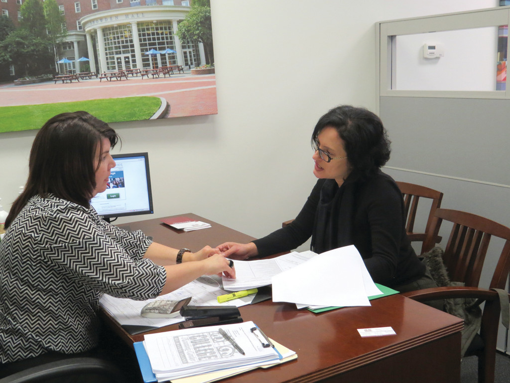 ALWAYS ACCEPT HELP: Warwick resident Carmen Garcia goes over the FAFSA filing process with counselor Ellen Russo at the Warwick Mall College Planning Center of Rhode Island. Although Garcia has been through this three times, she plans to continue to use the resources at the Center every year because she trusts their work will be correct.