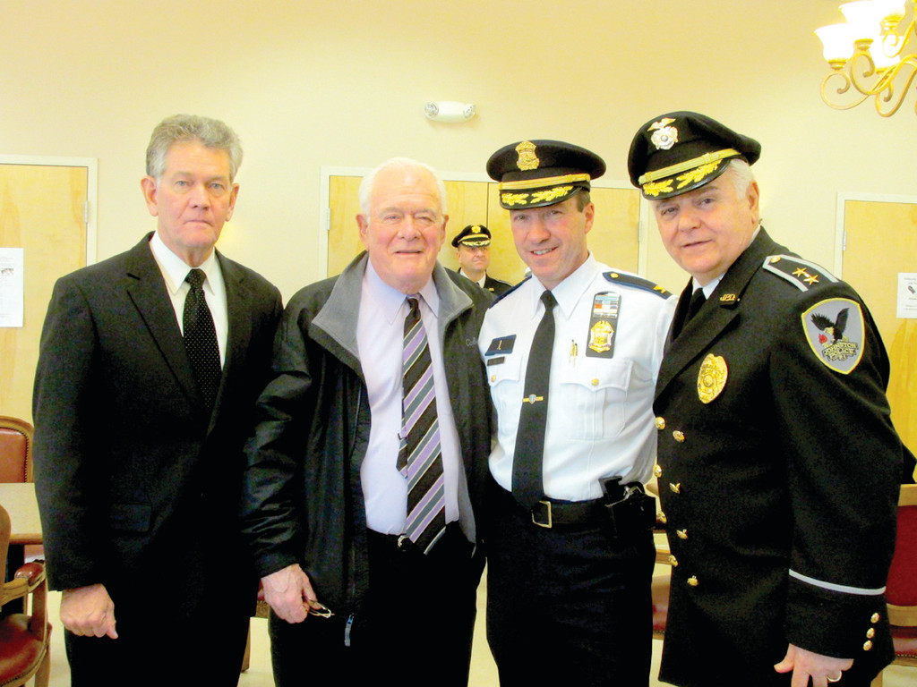 SERVE AND PROTECT: These four law enforcement personnel have a combined total of over 120 years of dedicated service to the Providence Police Department. They were also on hand last Friday when Johnston Police Chief Richard S. Tamburini, right, promoted two Johnston officers. Tamburini is joined by Col. Richard Sullivan, William Devine and current Providence Chief Col. Hugh Clements.