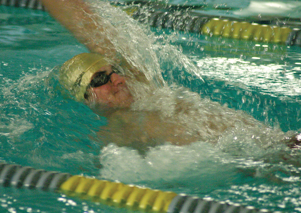 BACKING IN: Hendricken's Marc Andrews competes in the 100 backstroke during Thursday's meet against East Greenwich.