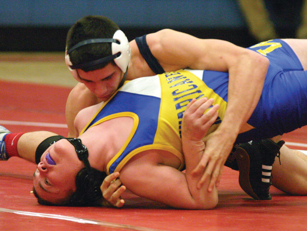 Toll Gate's Aaron Travers pushes for a pin in his 145-pound match against Vets' Kendall Watts at Thursday's City Championship.